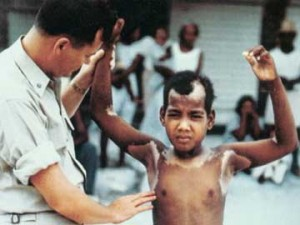 Rongelap child being inspected for radiation burns