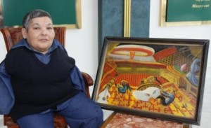 Karipbek Kuyukov, Ambassador for the ATOM project, with one of his paintings