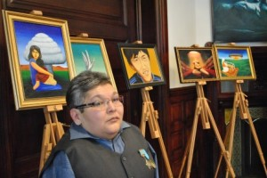 Karipbek with some of his art in the historic US Senate Kennedy Caucus Room for a PNND event in Feb 2014